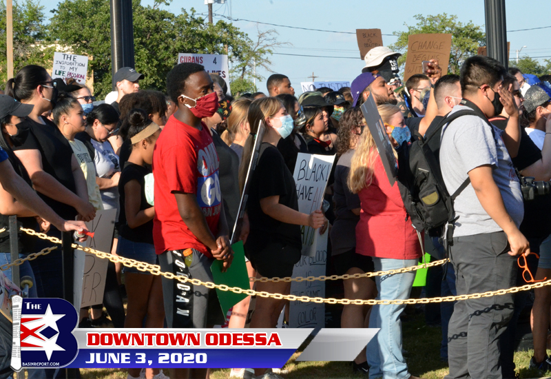 Protestors march the downtown streets of Odessa, Texas